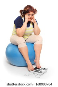 Depressed woman with measure tape and weighing machine.