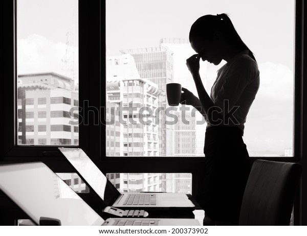 Depressed woman in the office.
