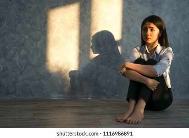 Depressed woman sitting in living room, alone, sadness, emotional concept