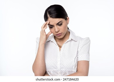 Depressed woman touching her forehead