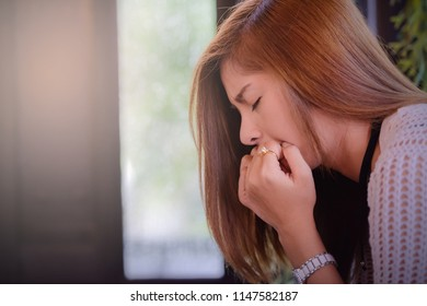 Depressed women. Asian beautiful girl sit on a chair in a coffee shop.