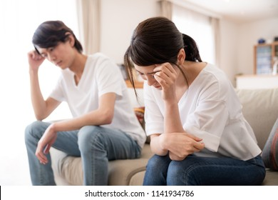 Depressed young couple in the house.