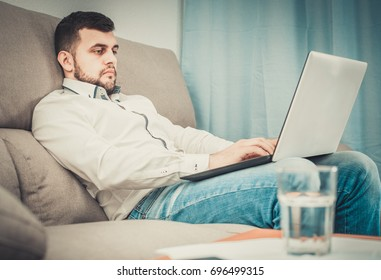 Depressed young male spending day alone at home