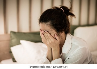 Depressed young woman concept. Female hand cover her face as crying from sad emotion or  healthcare mental health problem of depression