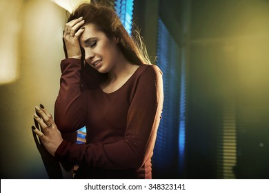 Depressed young woman at the evening