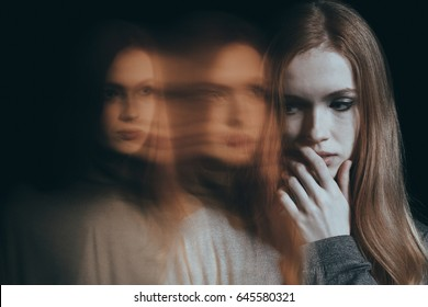 Depressed, young woman feeling sad and lonely
