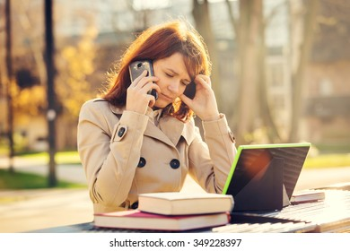 Depressed Young woman getting bad news by phone, Portrait student woman upset sad,unhappy, serious talking on phone