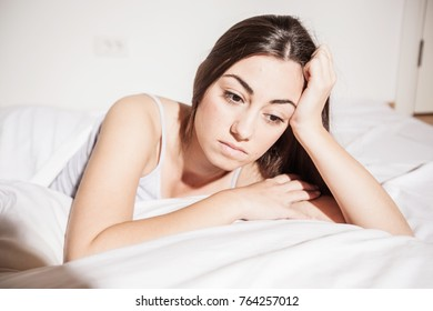 Depressed Young woman with insomnia in bed cant sleep