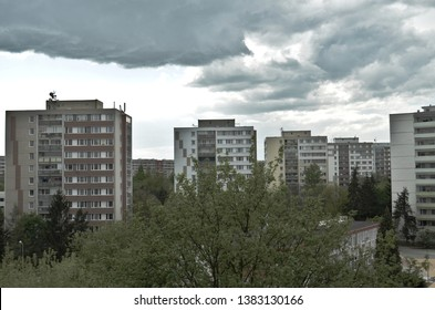 Depressing view of ugly communist building blocks (panelak) on a cloudy day at Prague on an average concrete buildings estate