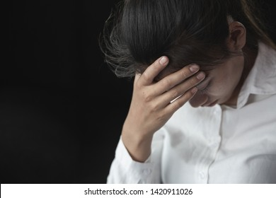 Depression or domestic violence Concept, Desaturated grunge image of a very sad adult woman crying
