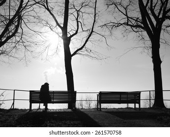 depression in the fog alone on the park bench