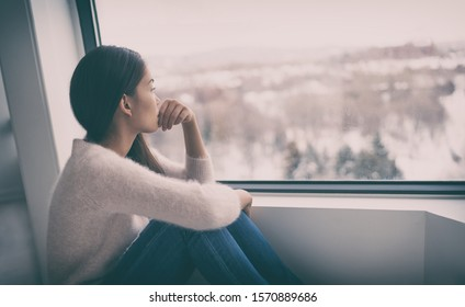 Depression, mental health, psychology therapy - mind wellness well being Asian girl with winter blues seasonal affective disorder feeling sad or heart broken with breakup alone. Loneliness, burnout