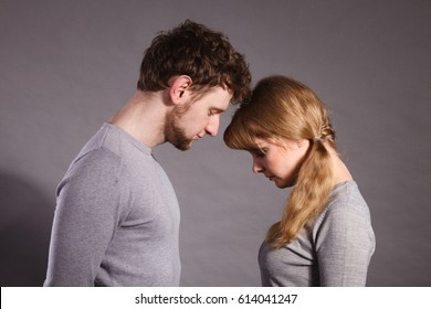 Depression and sadness concept. Unhappy depressed couple after argument. Sad woman and disappointed man standing together.