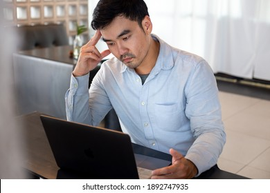 depression serious people from work,study stress concept.asian man feeling tired suffering using computer working work place.concept global economic,health problems