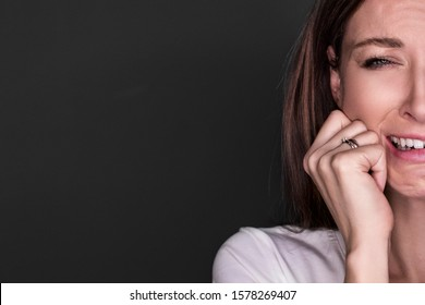 Depressive girl crying Portrait of sad crying pensive mad crazy Europian woman (expression, facial), Closeup  woman isolated on gray background place for text advertising antidepress half face