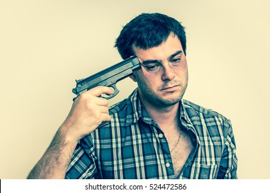 Depressive man trying to commit suicide with a gun aiming on his head - retro style