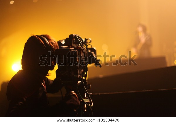 Depth of field image of an unidentified cameraman at an unknown concert in Tokyo, Japan