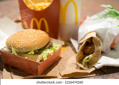 Depth of field view of a large Big Mac meal and a Peri Peri chicken wrap from McDonald's on a counter. Editorial. Taken on Thursday, 13 January in Brisbane, Australia.