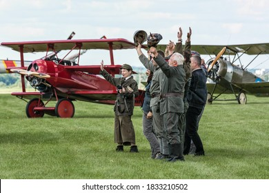Depultycze Krolewskie, Poland - June 11, 2016: Pterodactyl Flight display team greeting airshow public with Fokker DR1 and Sopwith Strutter in background at I International Air Picnic