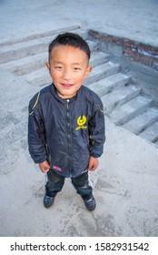 Deqin / China - May 2019: The chinese boy in Hongpo monastery in Meili Snow Mountain (Kawa Karpo) range in Deqin, Yunnan Province, South China.