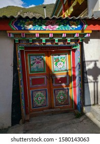 "Deqin / China - May 2019: The streets of Hongpo monastery in Meili Snow Mountain (Kawa Karpo) range in Deqin, Yunnan Province, South China.  Translation is ""Gaindan Yangbajain Forest Temple""."
