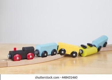 Derailed toy train - Conceptual image failure, lack of concentration