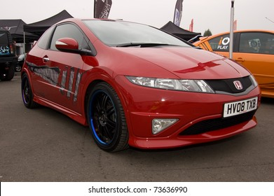 DERBY, ENGLAND - APRIL 12: Red Honda Civic Type R on April 4, 2009 in Derby, England, UK.  Donnington Race Circuit is Host to Annual International Styling and Tuning Automotive Show