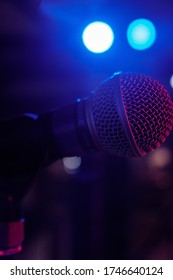 DERBY, UNITED KINGDOM - Dec 15, 2019: Close up of Shure SM58 microphone taken under concert lighting on stage during sound check at a live music venue