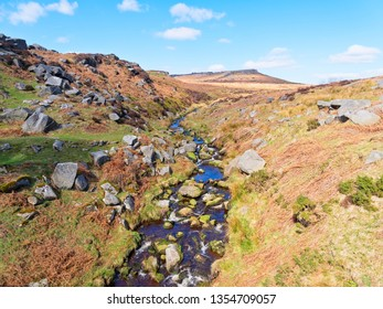 In the Derbyshire Peak District Burbage Brook flows over and around gritstone rocks.