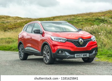 DERBYSHIRE, UK- SEPTEMBER, 2018: A red Renault Kadjar in a countryside setting. Renaults new SUV car model