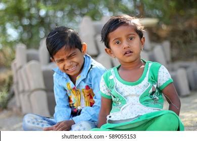DERDE KORHALE, INDIA – February 25, 2016: Indian rural child posing, giving expressions, Kopergaon, Ahmednagar, Maharashtra, India, Asia.