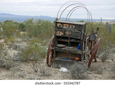 Derelict abandoned wild west chuck wagon in a desert landscape
