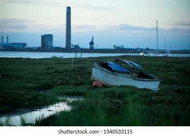 A derelict boat at the riverside