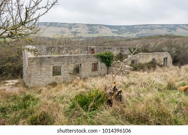 Derelict buildings in the abandoned village of Tyneham in Dorset England owned by the MOD