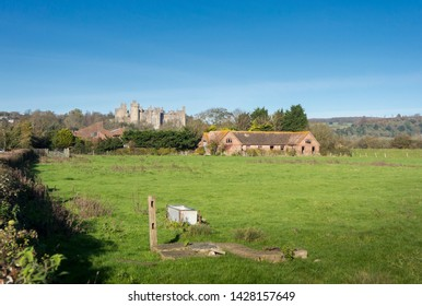 A derelict farmhouse with Arundel Castle in the background, Arundel, Sussex, UK