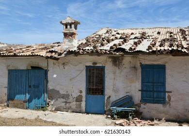 Derelict house with blue door on Crete, Greece