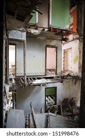 Derelict House: A derelict house with several floors, doors and walls missing.
