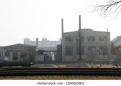 Derelict old industrial buildings and train track