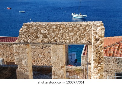 A derelict old stone building by the harbour at Emborio on the Greek island of Halki.