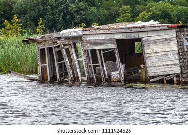 Derelict Places: Abandoned Fisherman's Cabin on River's Edge