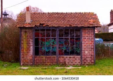 Derelict shed with broken windows