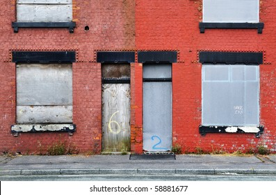 Derelict terraced house, boarded up and awaiting demolition.