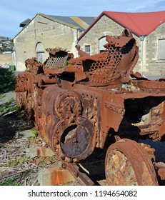 Derelict and totally rusted old Train Engine awaits restoration at the Steampunk HQ, Oamaru, New Zealand