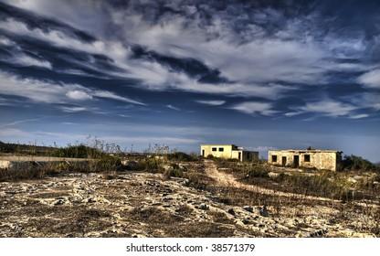 Derelict wartime British barracks lying in ruins at Selmun in Malta