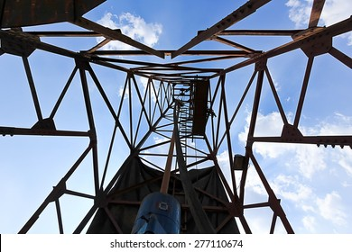 Derick of old water well drilling with blue sky