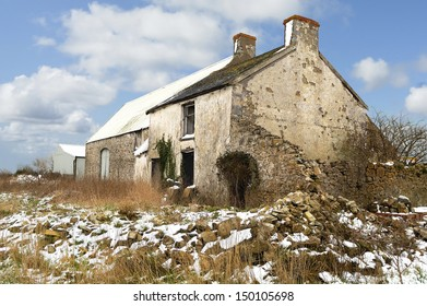 Derict farm building in South Wales, UK. Snow on ground.