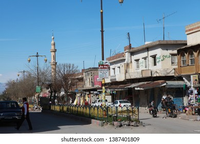 DERIK, SYRIA- In the third year of the war, people are on the street and the shops are open in the square of the city of Derik in the north of Syria controlled by the Kurds. March 20, 2013.