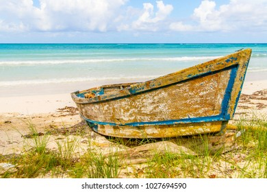 Derilict boat abandoned on the beach at Falmouth, Jamaica