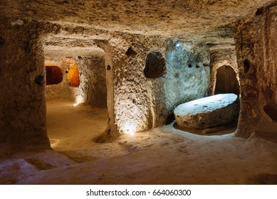 The Derinkuyu underground city is an ancient multi-level cave city in Cappadocia, Turkey. Stone used as a door in the old underground city