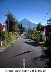 a derivative road in the trawas area on Indonesia's independence day - Shutterstock ID 1853785960